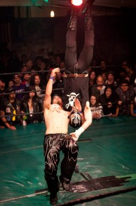 Juiced Lee delivers a brain buster to Lucha Magnifico